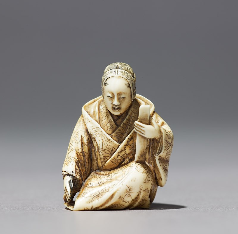 Netsuke in the form of a Nō actor wearing a mask (front           )