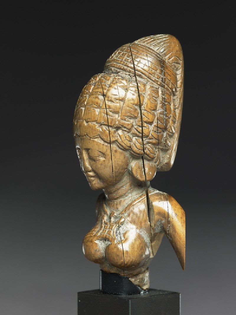 Female figure with a tall headress