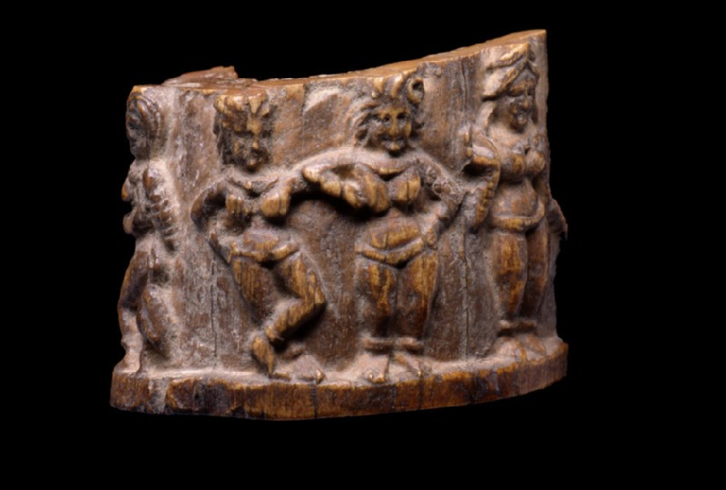 Cylindrical fragment carved with female figures in various poses (EA1996.86)