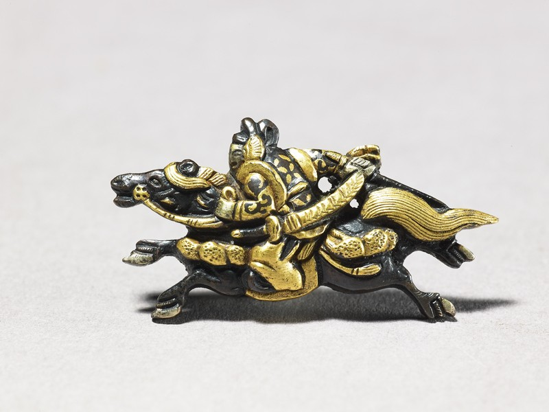 Menuki in the shape of mounted samurai