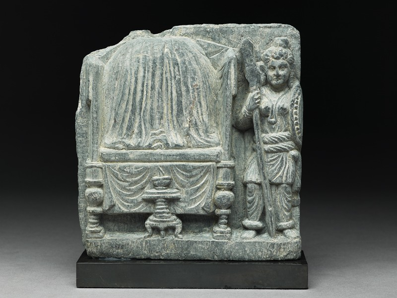 Relief fragment depicting a female warrior guarding the Buddha's relics (front           )