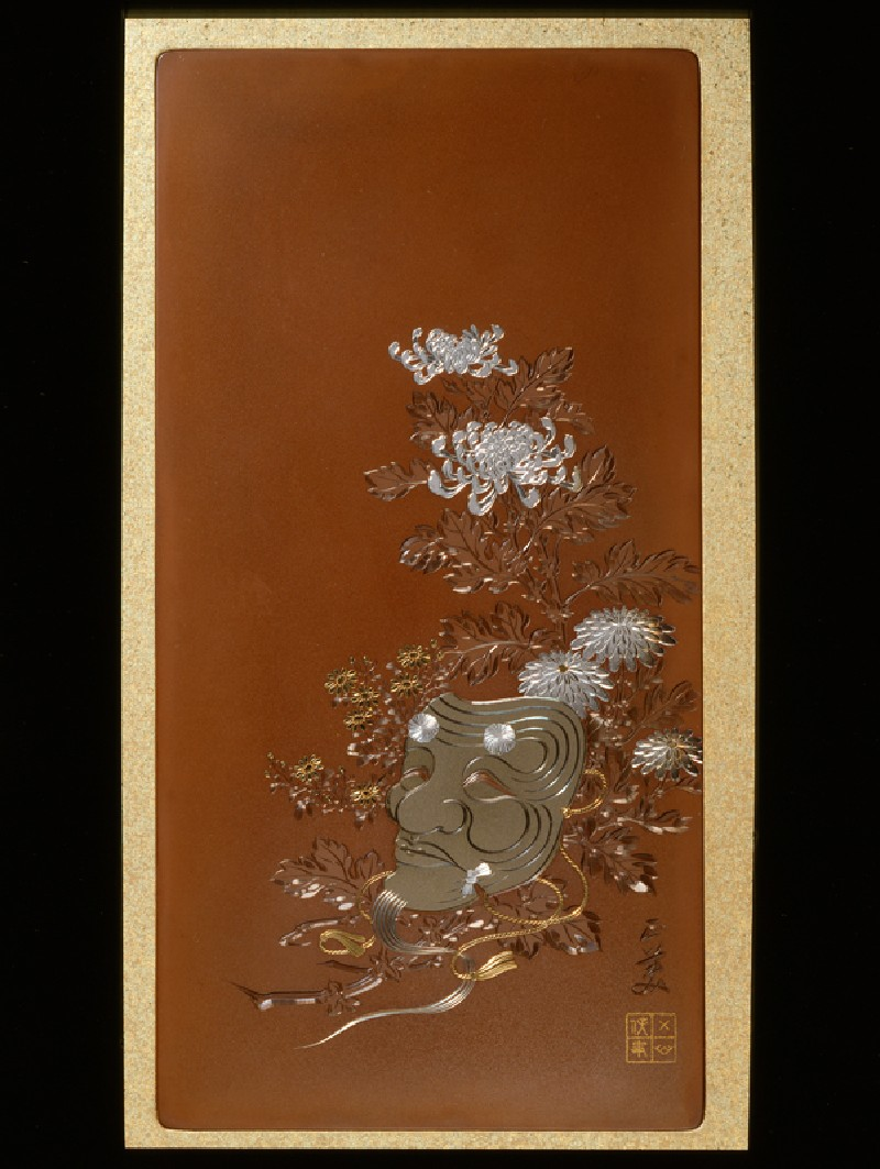 Panel with a mask of Okina lying on flowers