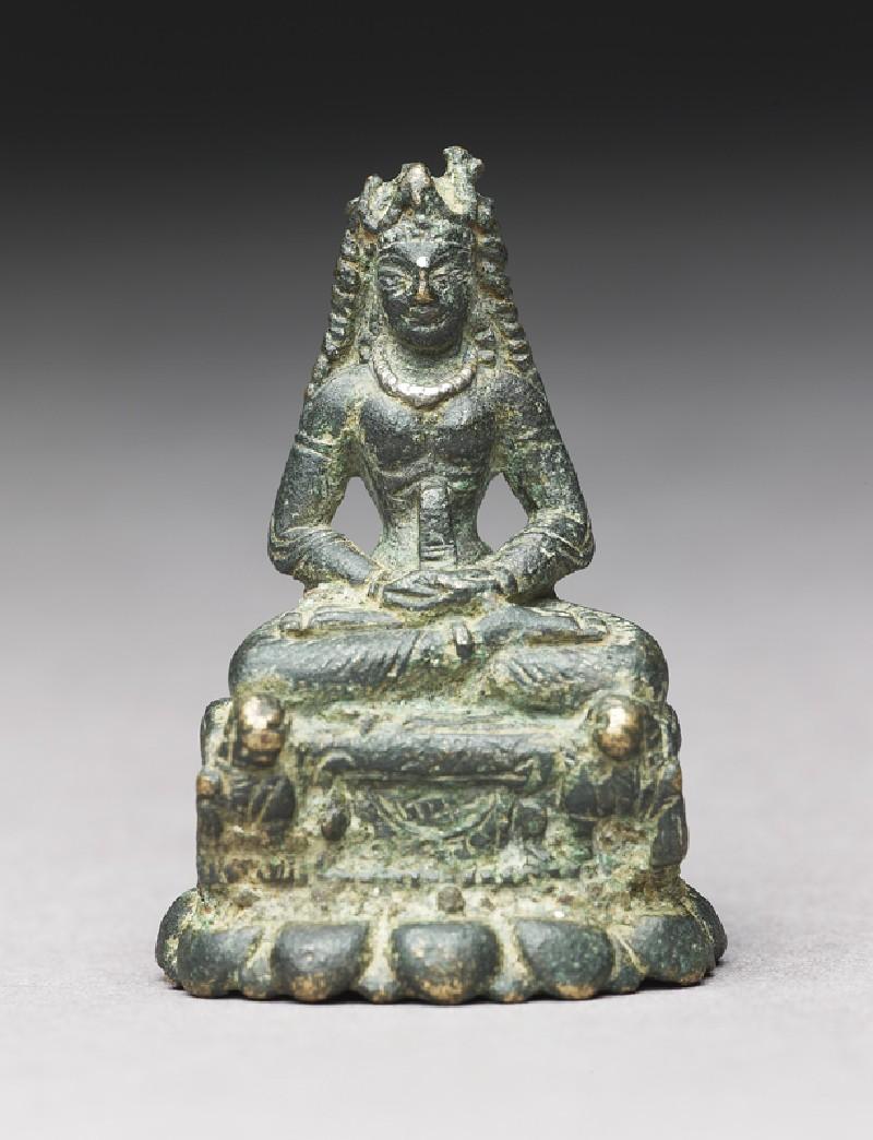 Figure of Chandu or Prajnaparamita seated on lion throne (front            )