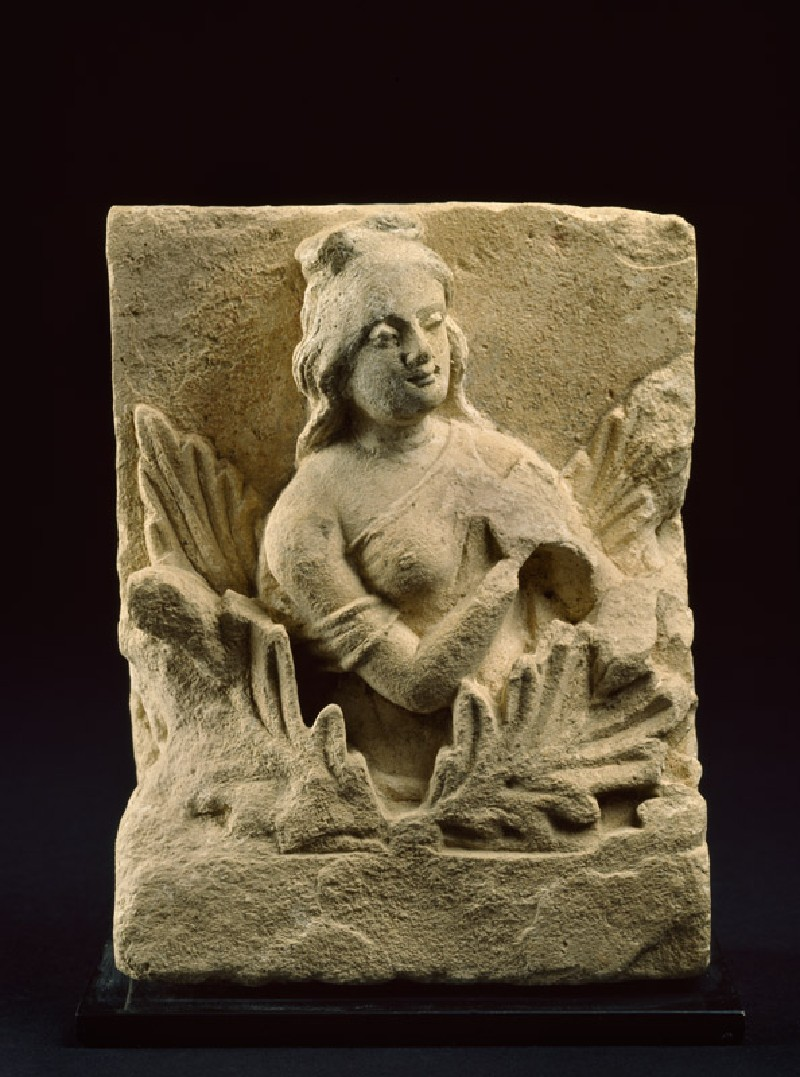 Frieze fragment depicting a female attendant among acanthus leaves (front            )