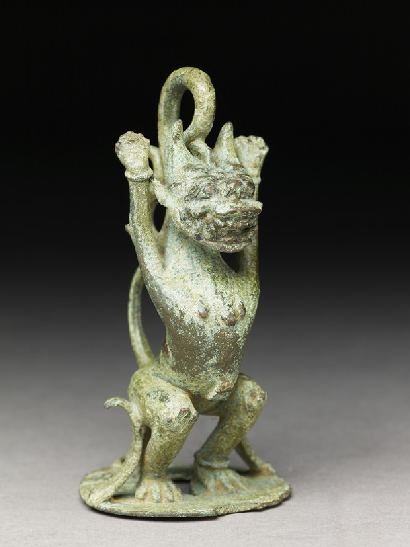Finial for a lamp or bell in the form of a singha lion (oblique            )