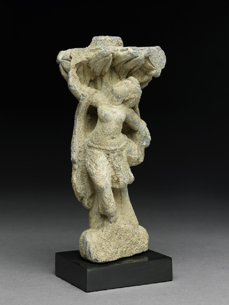 Relief fragment depicting a female dancer beneath a tree