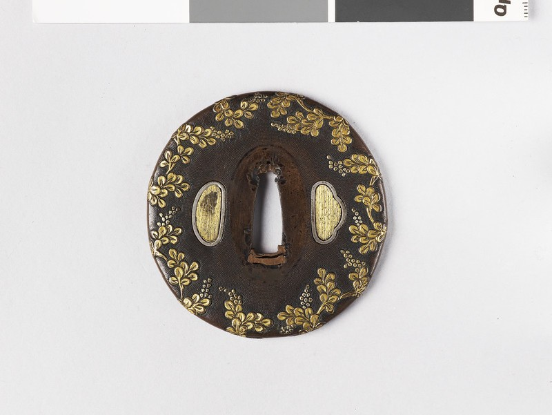 Round tsuba with design of flowers (front           )