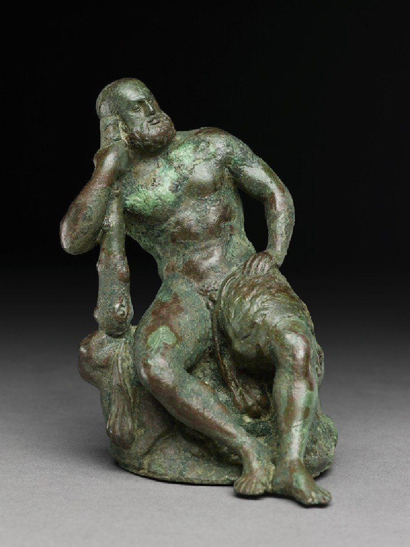 Figure of the hero god Heracles with his club seated on a lion