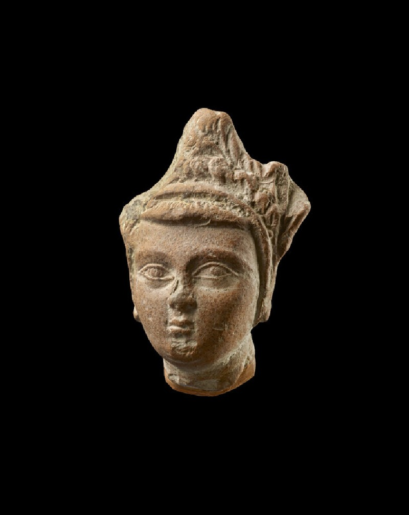 Head of a figure wearing a crown