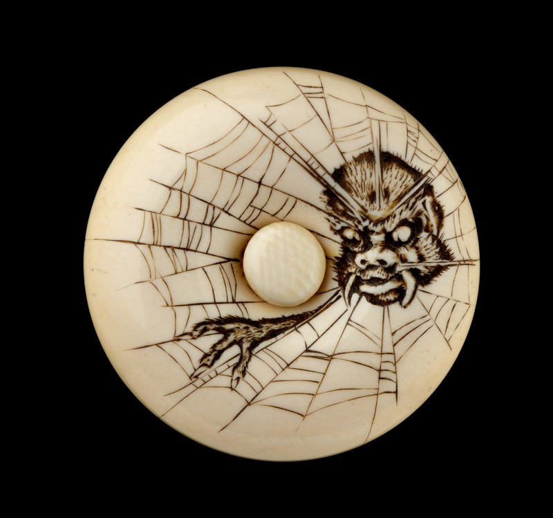 Manjū netsuke depicting the Earth Spider in a web