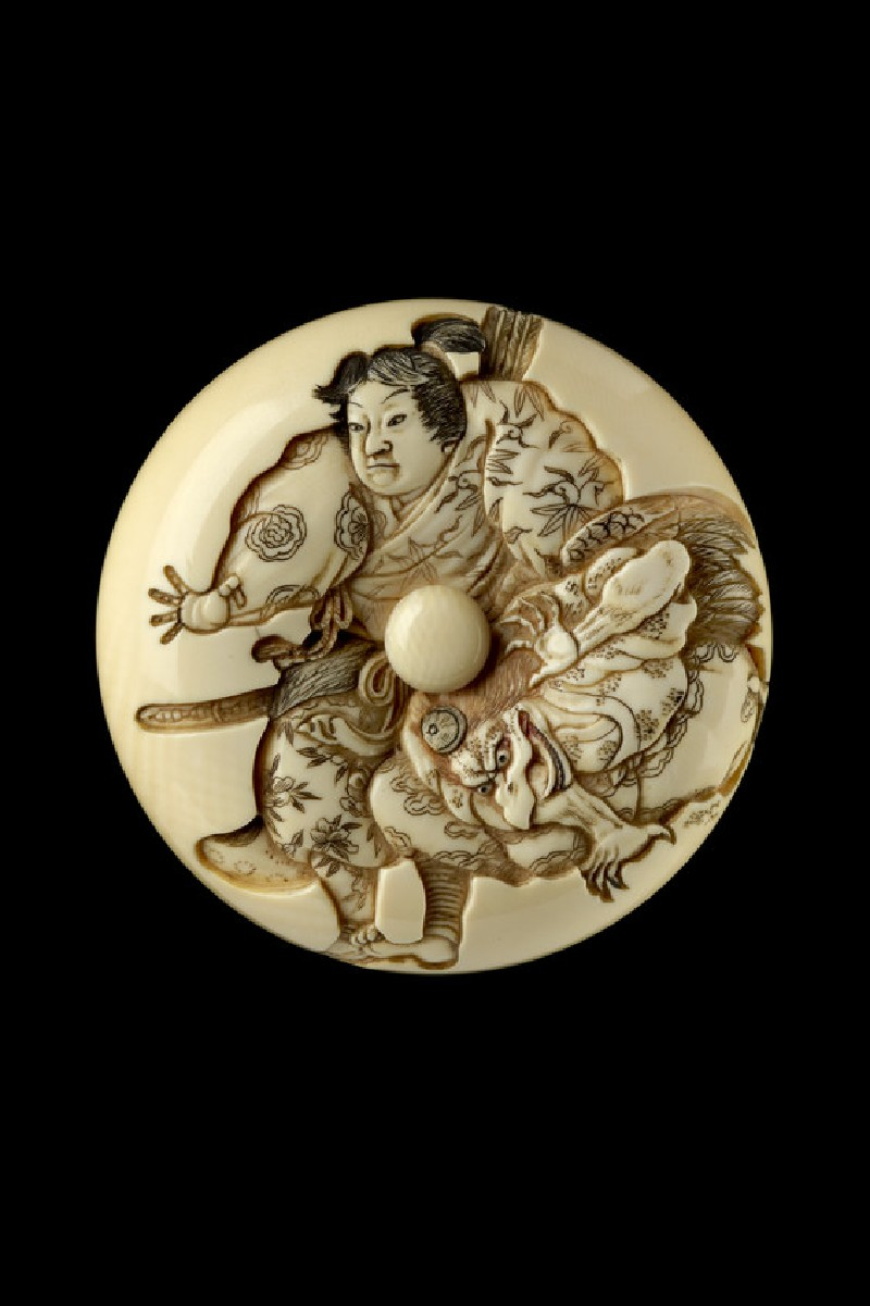Manjū netsuke depicting Minamoto Yoshitsune practising martial arts with a tengu demon (front            )