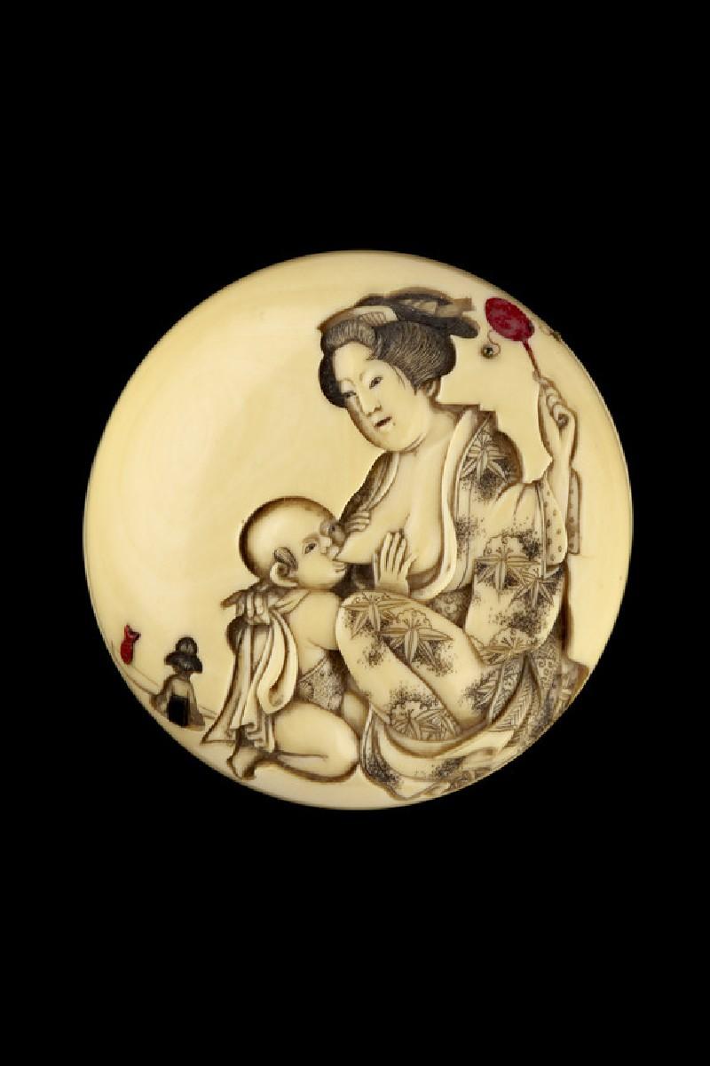 Manjū netsuke depicting a mother feeding her baby (EA2001.116)
