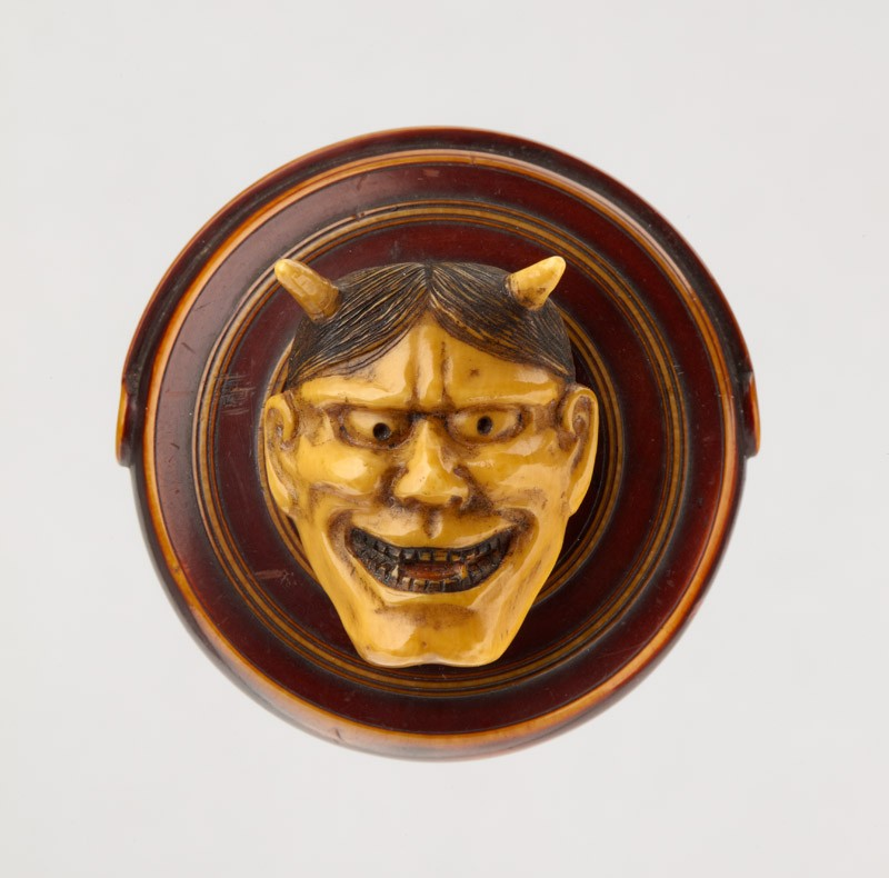Manjū netsuke in the form of a temple gong and Hannya mask from the Nō play 'Dōjōji'
