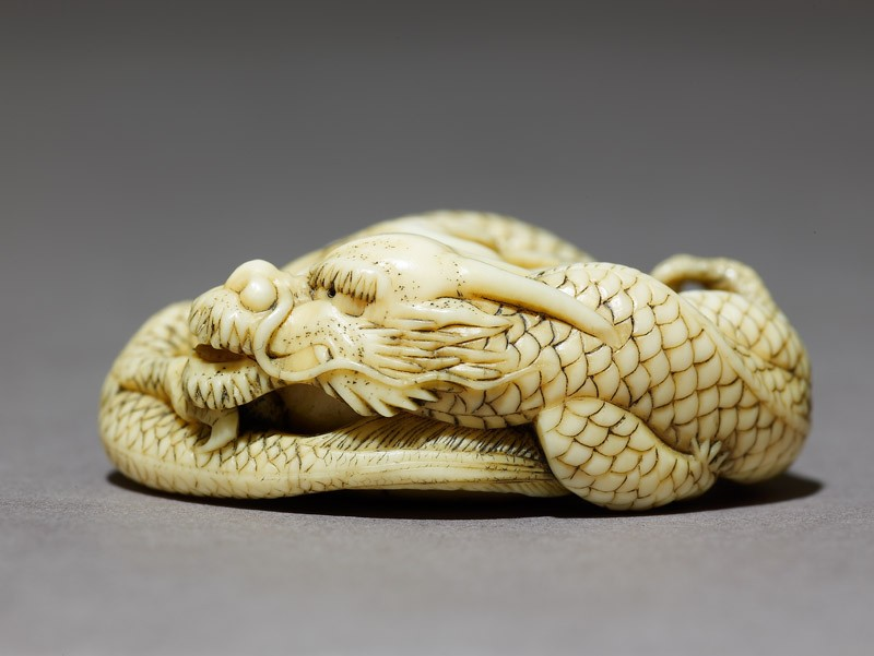 Netsuke in the form of a dragon coiled around a bowl (EA2001.125, side            )