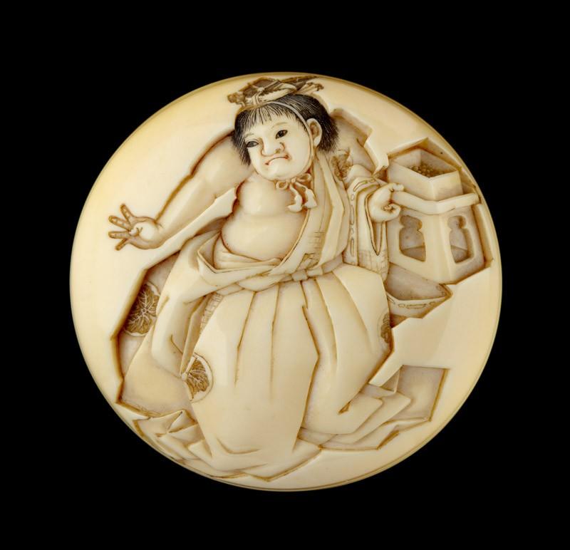 Manjū netsuke depicting a boy throwing beans at the Setsubun festival