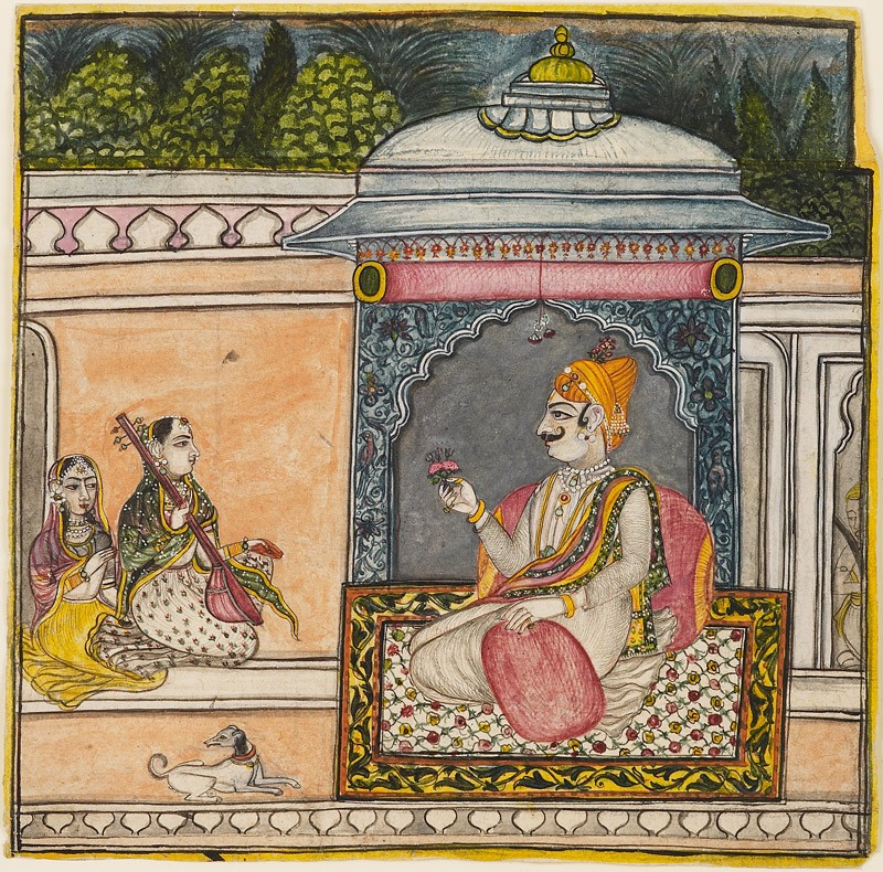 A Raja listening to music on a terrace (front           )