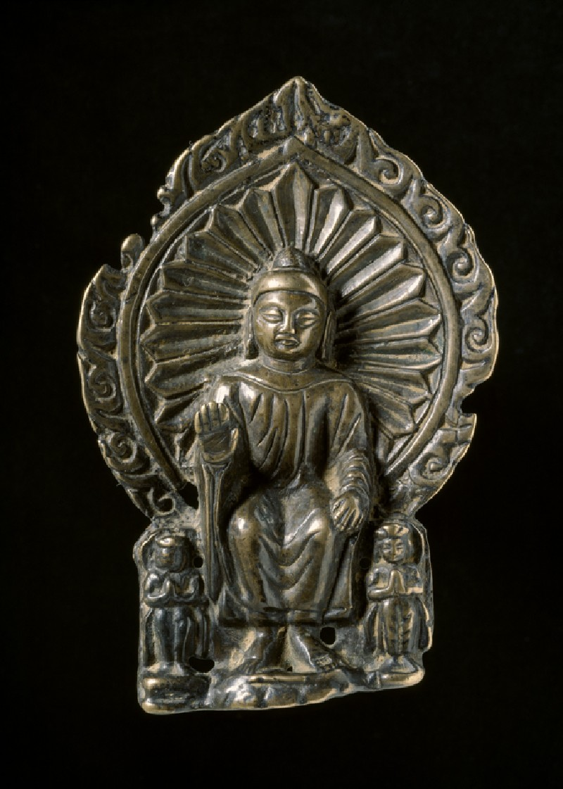 Seated figure of the Buddha with attendants (front            )