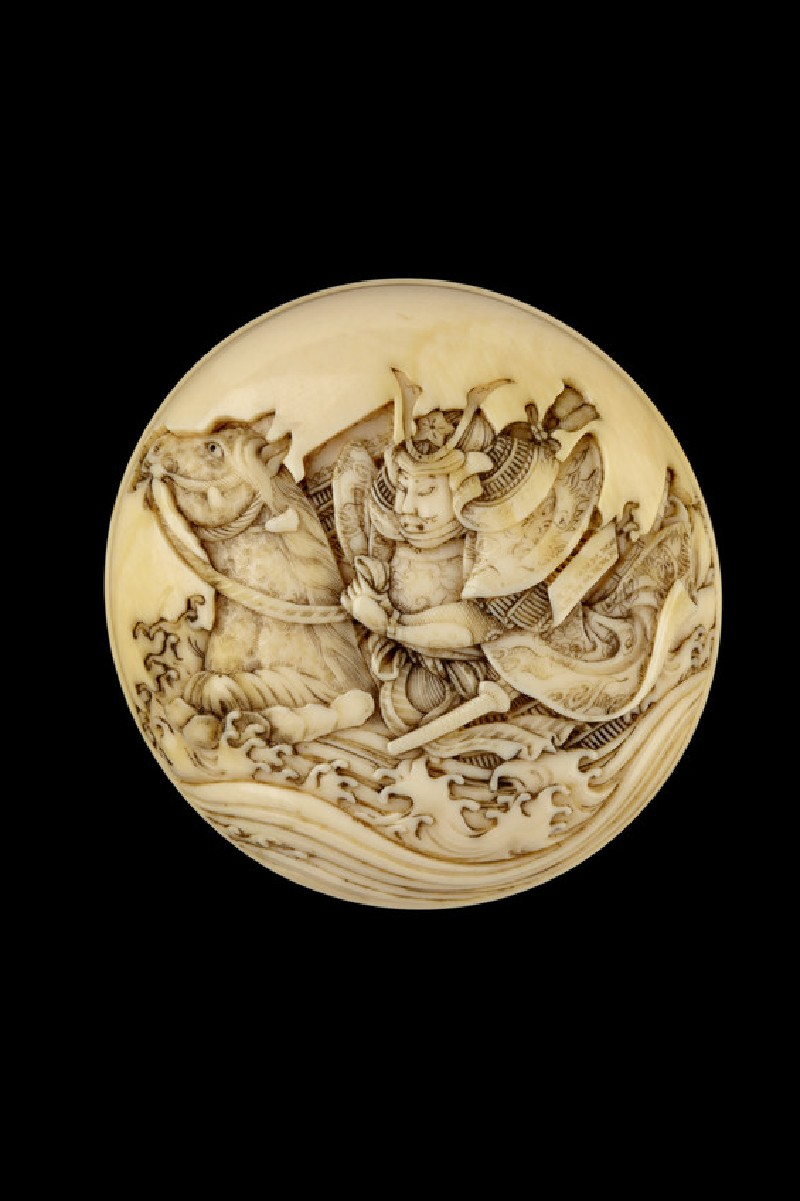 Manjū netsuke depicting a warrior racing through a river on horseback