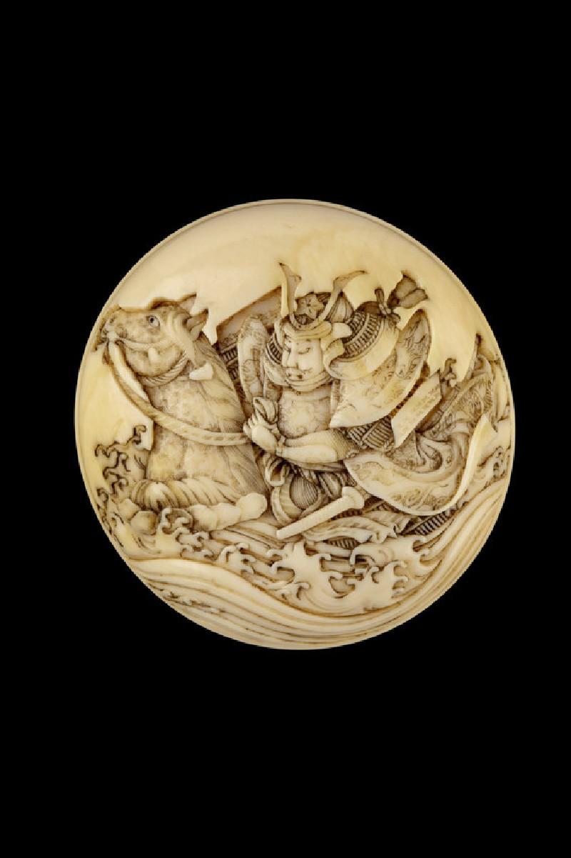 Manjū netsuke depicting a warrior racing through a river on horseback