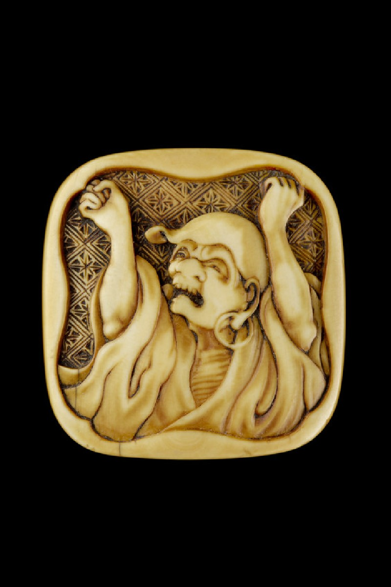 Manjū netsuke depicting Daruma stretching and yawning