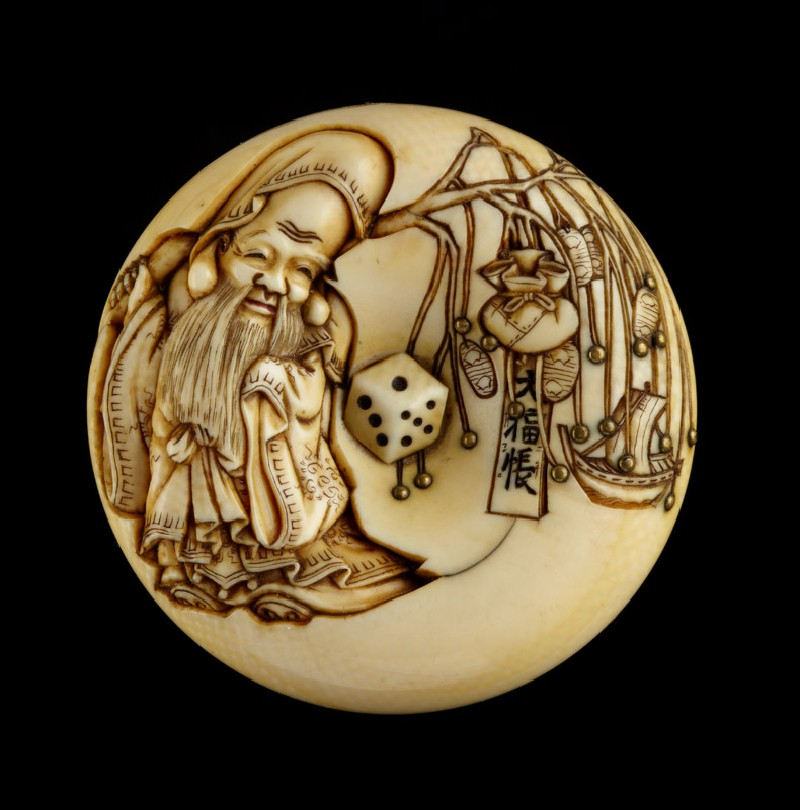 Manjū netsuke depicting Fukurokuju, one of the Seven Lucky Gods, carrying toys on a willow branch