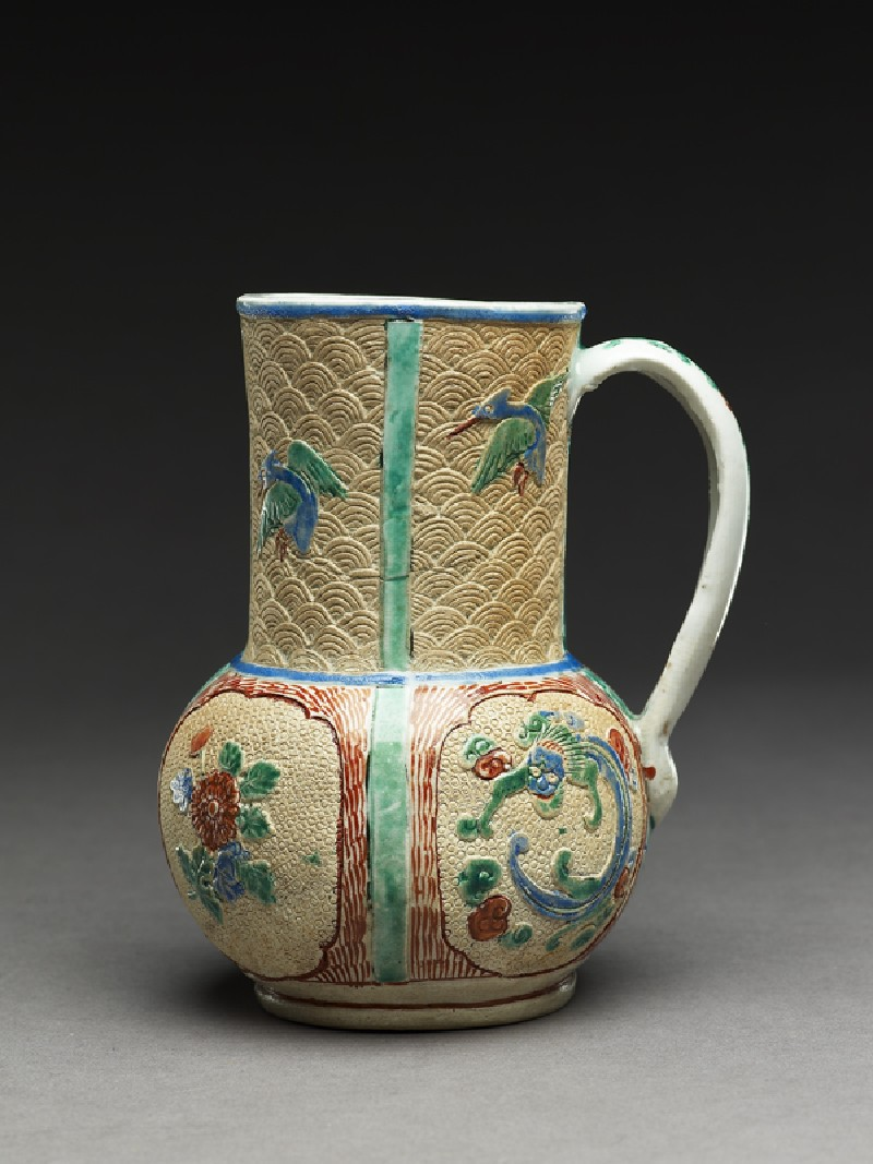Mug of European form with dragons, flowers, and birds