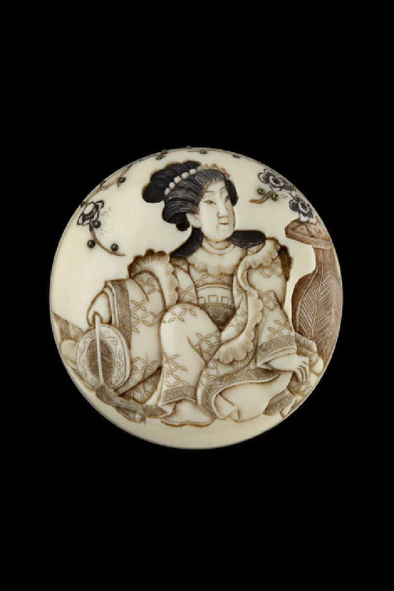 Manjū netsuke depicting the lady known as the Spirit of the Plum Tree