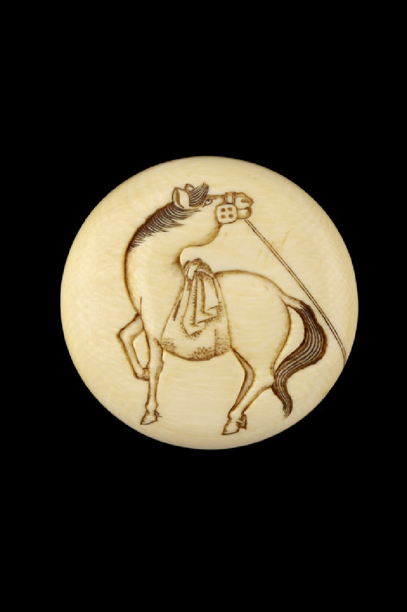 Manjū netsuke with a sacred horse. Reverse, a monkey tugs at the horse's tether