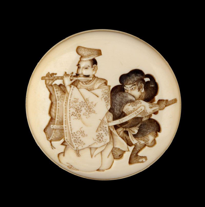 Manjū netsuke depicting Yasumasa playing his flute about to be attacked by the bandit Hakadamare (EA2001.95, front           )