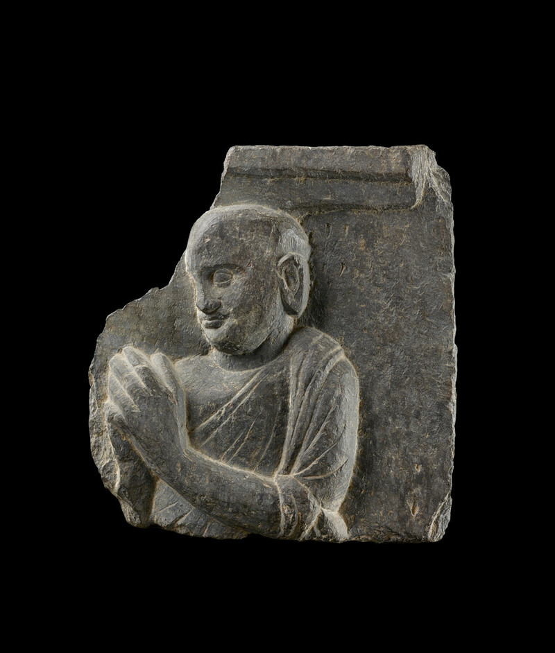 Relief fragment depicting a reverent monk