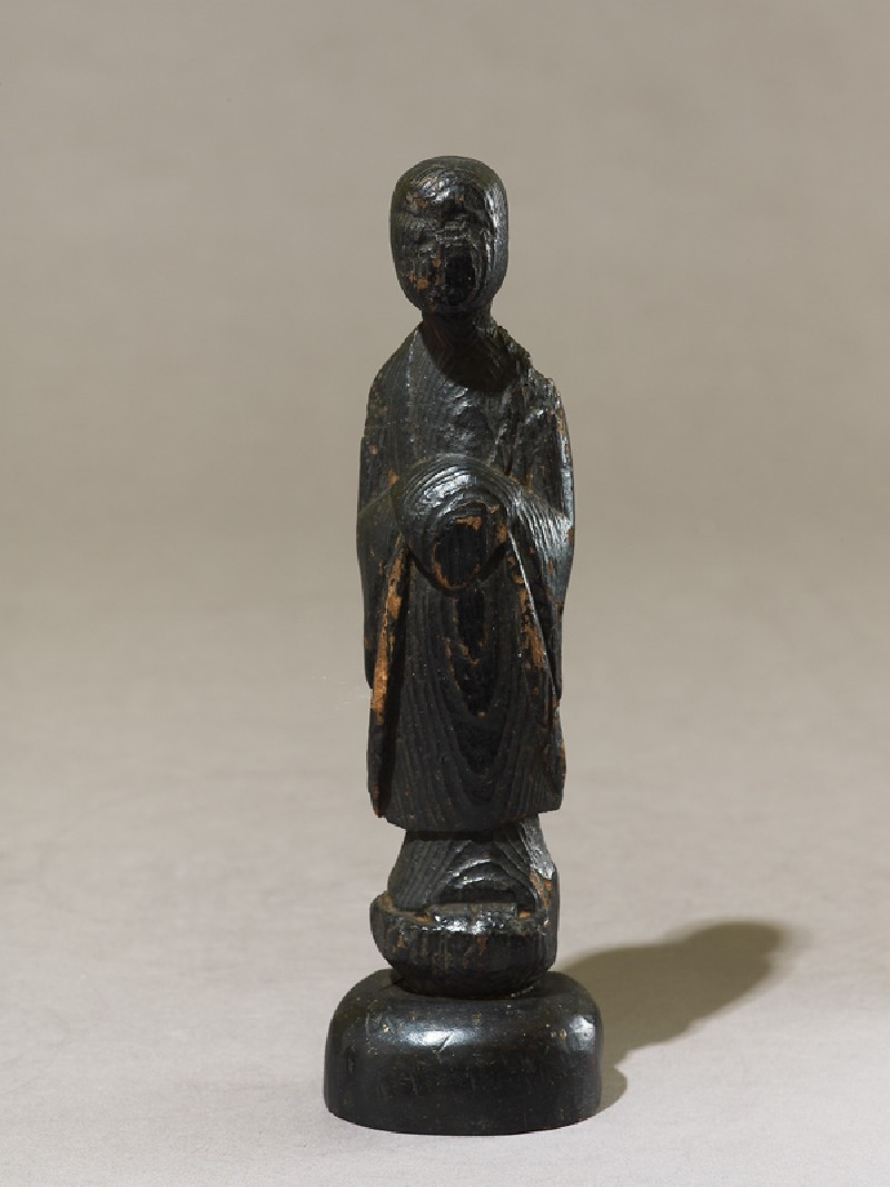 Standing Buddhist figure (oblique           )
