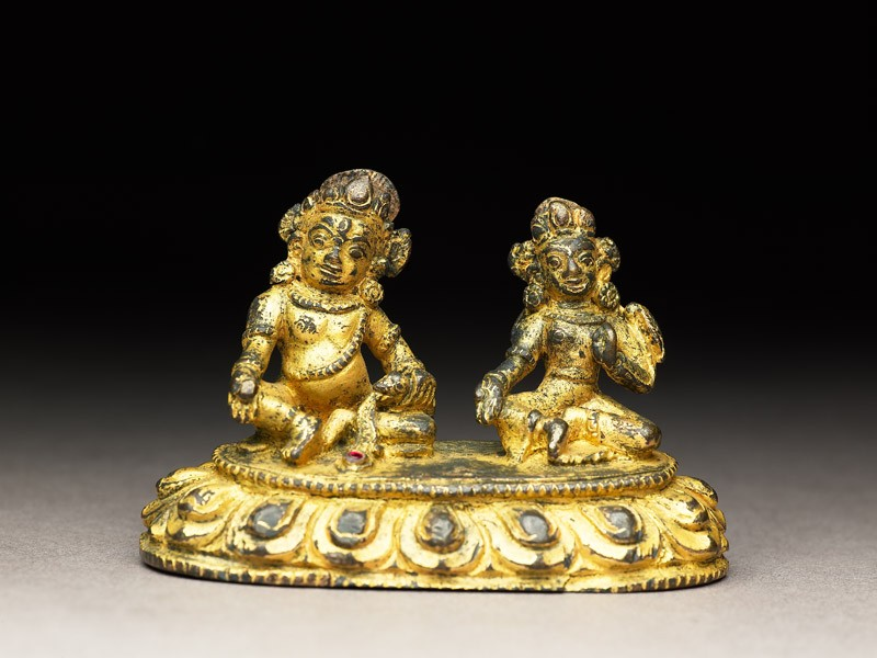 Figure of a male deity and his consort on a lotus-petalled throne