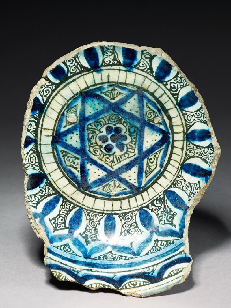 Base fragment of a bowl with star (top           )