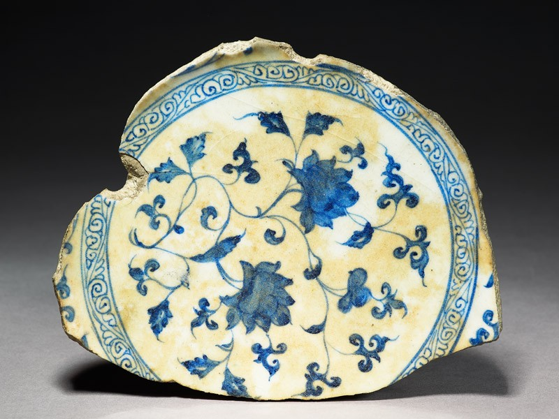 Base fragment of a bowl with flowers