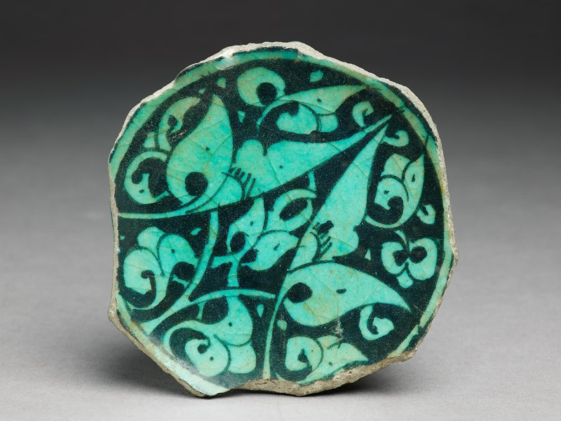 Base fragment of a bowl with floral decoration (top           )