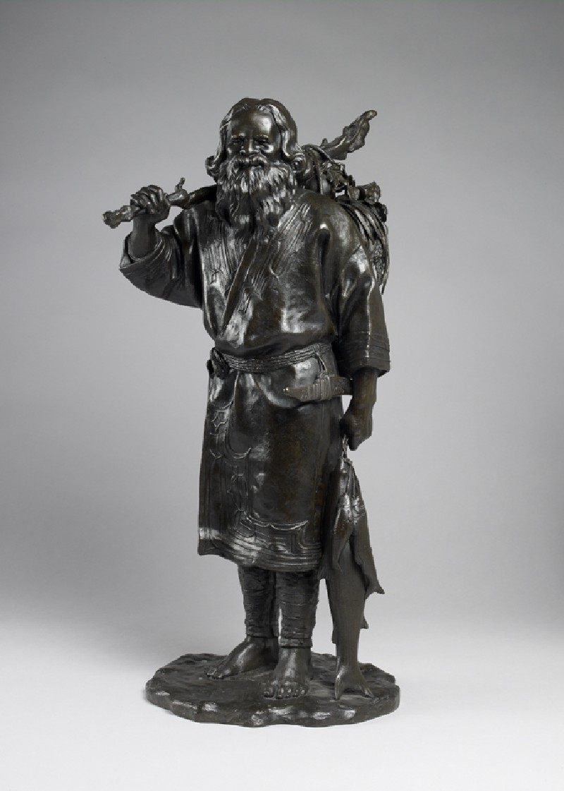 Figure of an Ainu fisherman with his catch