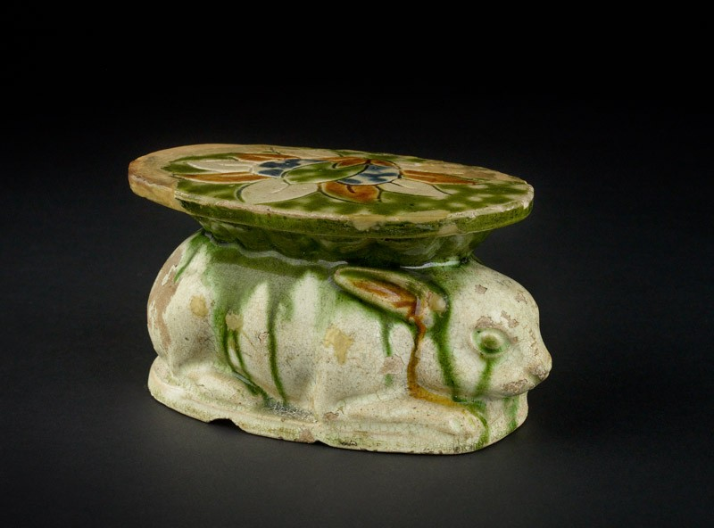 Pillow in the form of a rabbit with three colour glaze
