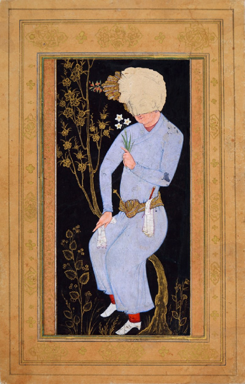 Turbaned youth holding a flower