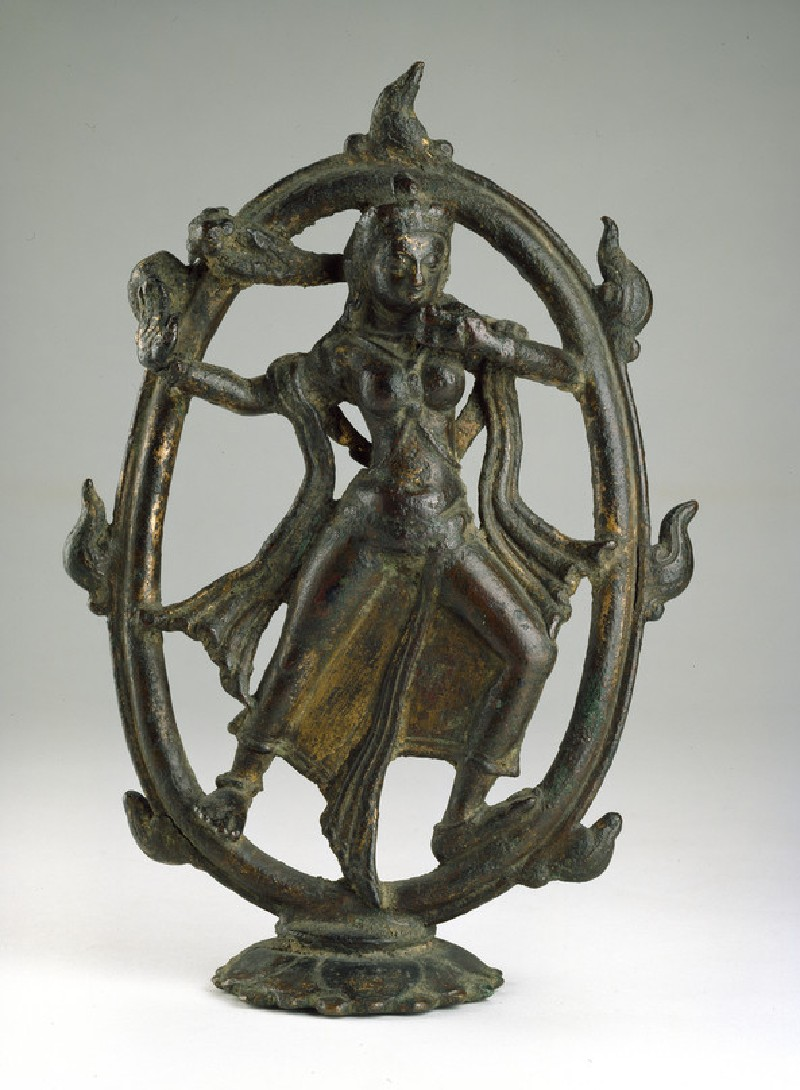 Figure of Devi dancing in a ring of fire (front           )