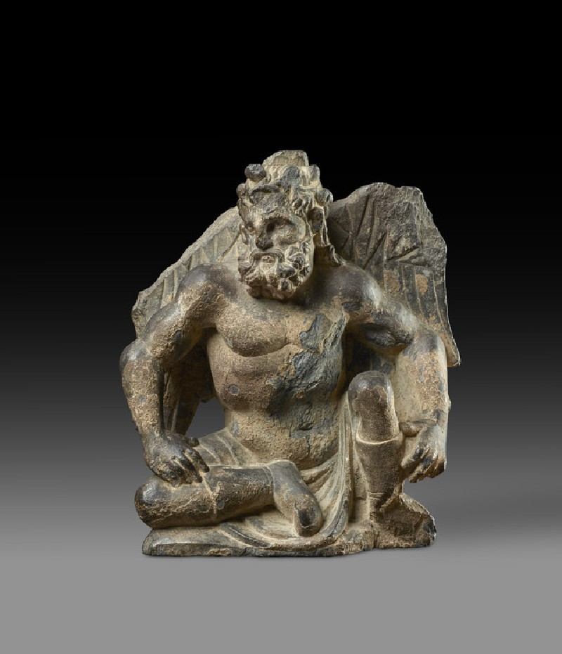 Relief fragment of a seated Atlas figure