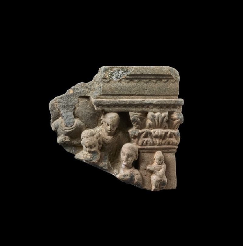 Relief fragment depicting four figures