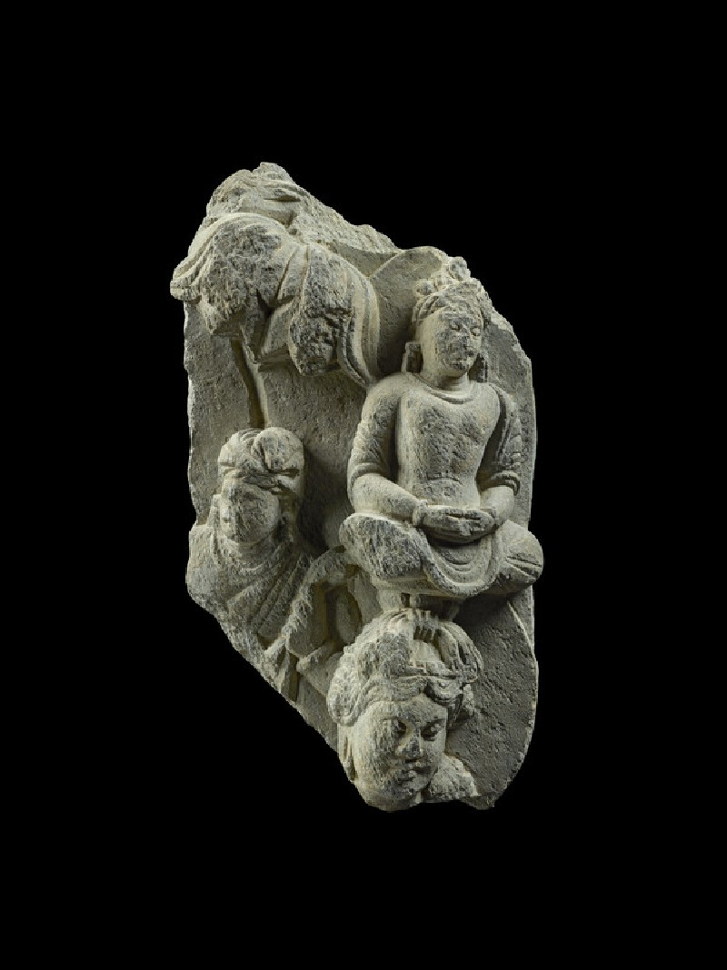 Relief fragment depicting three figures