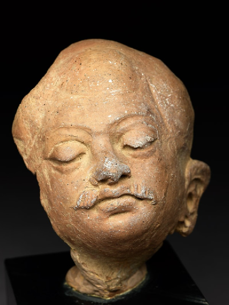 Head of a moustachioed man (EAOS.50, oblique         )