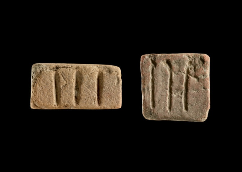 Rectangular object incised with three lines, probably a game counter, weight or sealing (EAX.144)