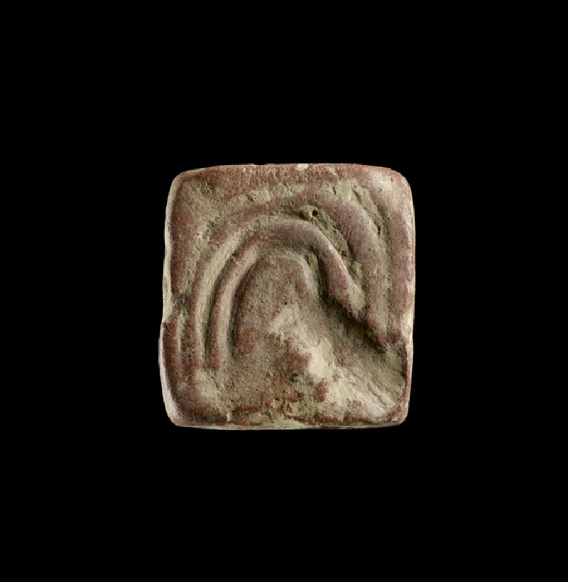 Squarish object incised with curved lines, probably a game counter, weight or sealing (EAX.147.b)