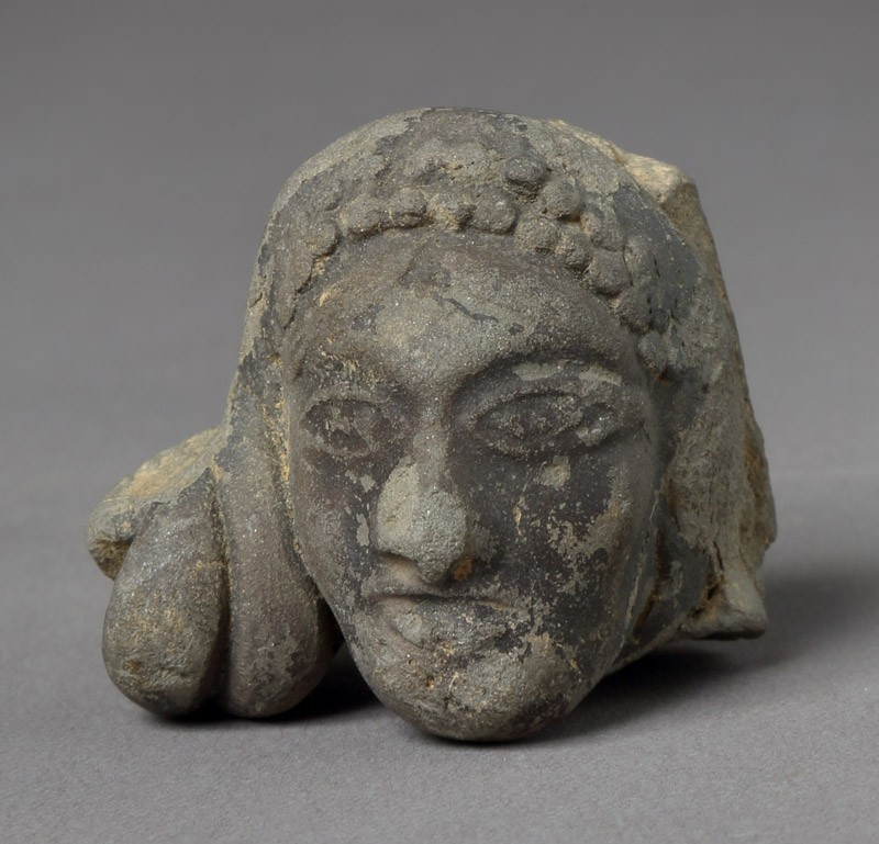 Head of a female figure (front         )