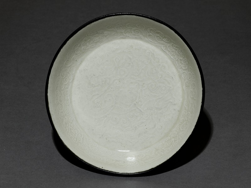 White ware bowl with dragons, flowers, and clouds