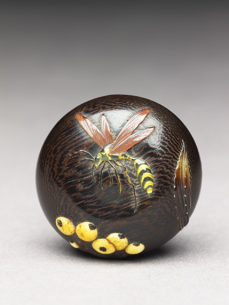 Manjū netsuke with wasp and berries