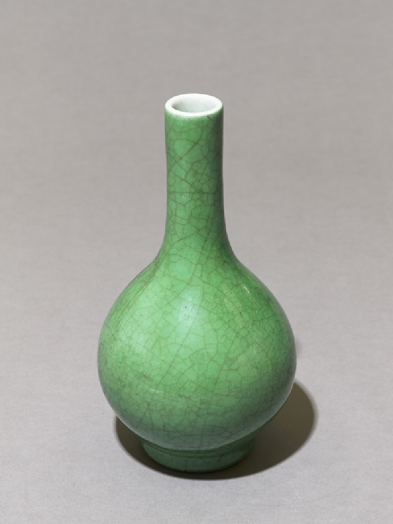 Tall-necked vase with green glaze