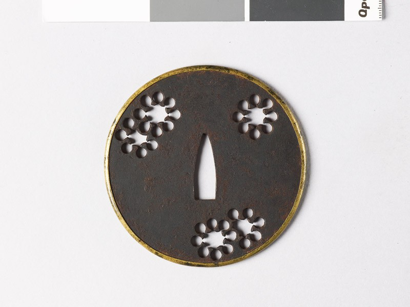 Round tsuba with 'nine-star' mon or snow (front           )